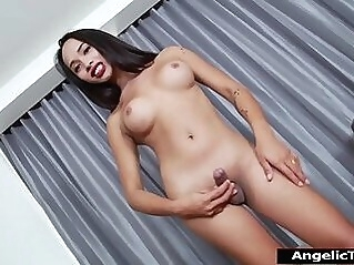 Busty Asian tgirl Cindy Love stripping naked and jerking off tranny brunette shemale